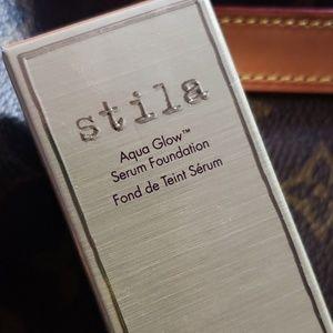 Stila Makeup - STILA aqua glow serum foundation.  TAN
